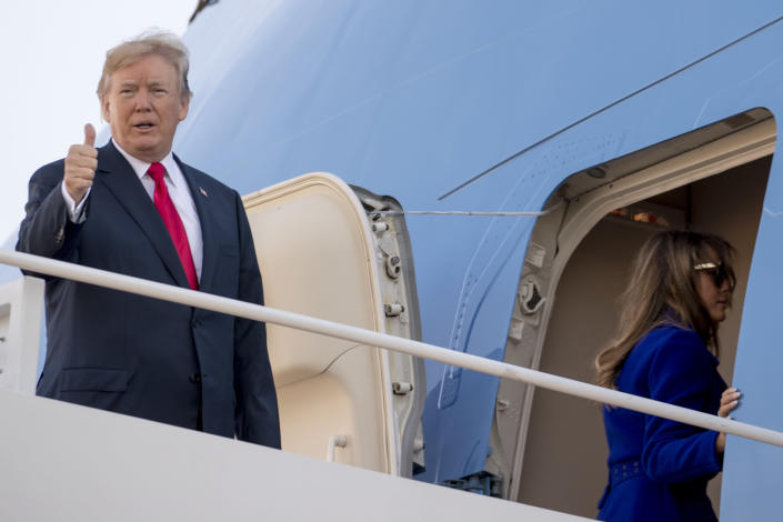 President Trump gives a thumbs-up as he and first lady Melania Trump board Air Force One at Andrews Air Force Base, Md. (Photo: Andrew Harnik/AP)