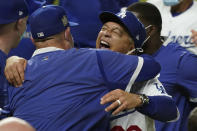 Los Angeles Dodgers manager Dave Roberts celebrates after defeating the Tampa Bay Rays 3-1 to win the baseball World Series in Game 6 Tuesday, Oct. 27, 2020, in Arlington, Texas. (AP Photo/Eric Gay)