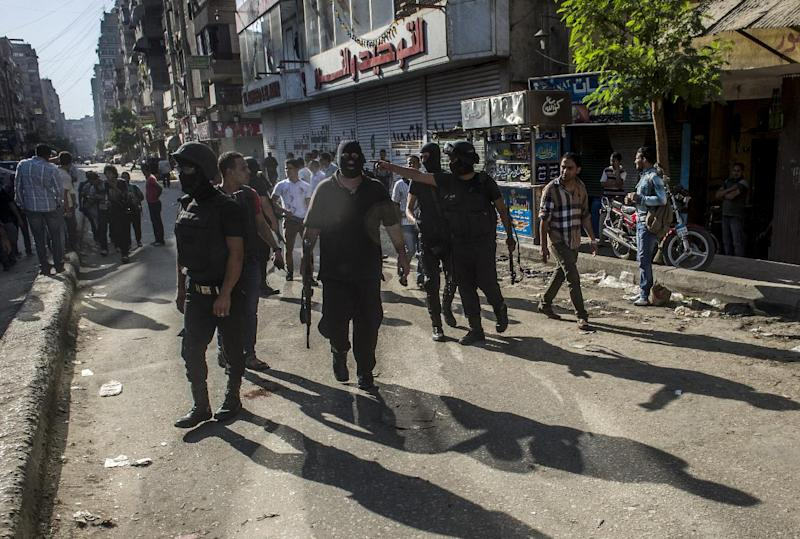 Egyptian riot policemen secure a street during a rally of supporters of the Muslim Brotherhood movement on July 3, 2014 in Cairo (AFP Photo/Khaled Desouki)