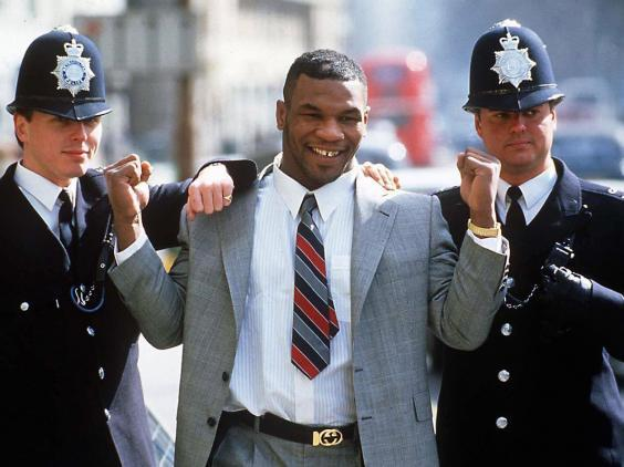 Mike Tyson posing with two police officers, in 1989 (Rex Features)