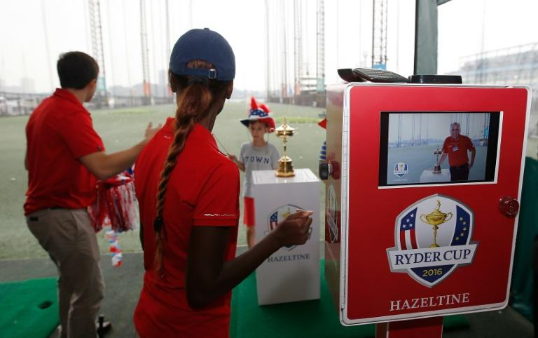 Children from the Golf Club camp have their photo made with the Ryder Cup, at Chelsea Piers in New York, on September 1, 2016