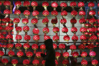 A woman prays in front of lanterns to welcome in the upcoming New Year at the Jogyesa Buddhist temple in Seoul, South Korea, Tuesday, Dec. 31, 2019. (AP Photo/Ahn Young-joon)