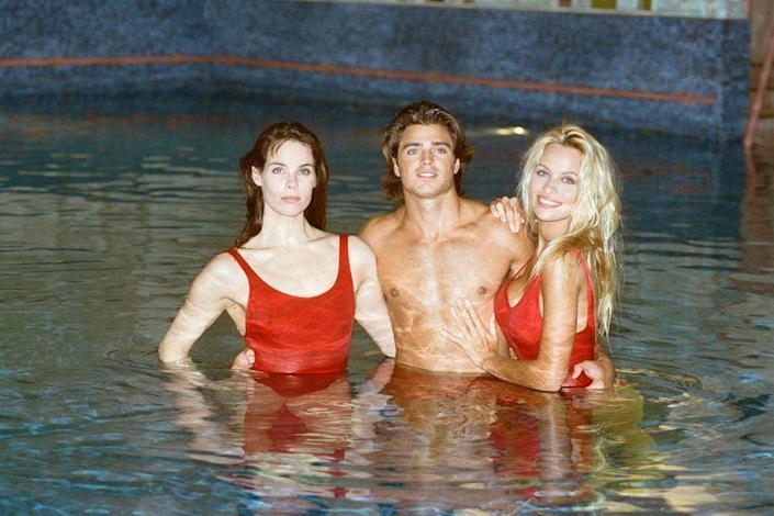 <p>Alexandra Paul, David Charvet, and Pamela Anderson pose for a <em>Baywatch</em> photo call in London in 1993. </p>