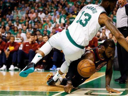 May 23, 2018; Boston, MA, USA; Boston Celtics forward Marcus Morris (13) falls on top of Cleveland Cavaliers forward LeBron James (23) after reaching for the ball during the first quarter of game five of the Eastern conference finals of the 2018 NBA Playoffs at TD Garden. Mandatory Credit: Greg M. Cooper-USA TODAY Sports
