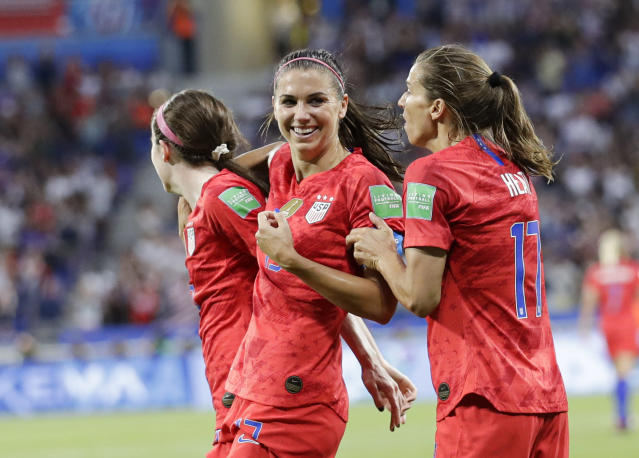 Alex Morgan (middle) is tied for the most goals at the Women's World Cup, but her on- and off-field evolution over the last eight years means her contributions go beyond the scoresheet, according to her U.S. teammates. (AP Photo/Alessandra Tarantino)