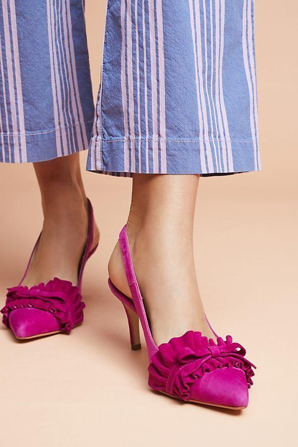 "Get them at <a href=""https://www.anthropologie.com/shop/elia-b-jennifer-ruffle-heels?category=SEARCHRESULTS&color=051&quantity=1&type=REGULAR"" target=""_blank"">Anthropologie</a> for $138."