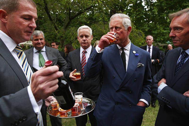 LONDON, ENGLAND - SEPTEMBER 11: Prince Charles, Prince of Wales samples beer during a reception to celebrate the 21st anniversary of Duchy originals products at Clarence House on September 11, 2013 in London, England. The reception was held in the gardens of Clarence House, and attended by Duchy suppliers, Waitrose and other international stockists, customers, charitable beneficiaries and representatives of some of the charities who benefit from the sale of the products. (Photo by Dan Kitwood - WPA Pool/Getty Images)