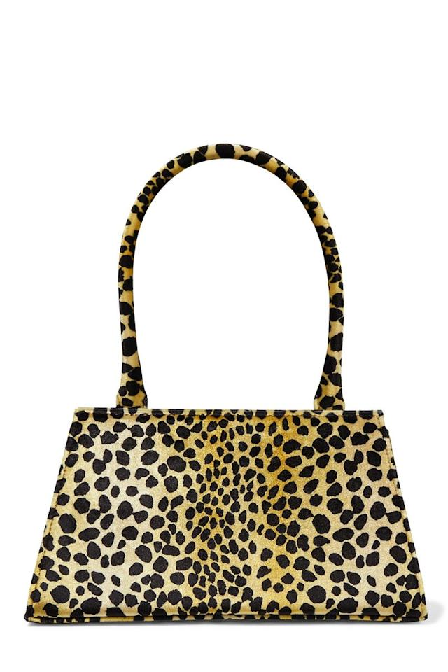 """<p>Dora animal-print velvet tote, £255, Rixo</p><p><a class=""""body-btn-link"""" href=""""https://go.redirectingat.com?id=127X1599956&url=https%3A%2F%2Fwww.net-a-porter.com%2Fgb%2Fen%2Fproduct%2F1181841%2Frixo%2Fdora-animal-print-velvet-tote&sref=http%3A%2F%2Fwww.cosmopolitan.com%2Fuk%2Ffashion%2Fstyle%2Fg4098%2Fshop-best-designer-handbags-under-300%2F"""" target=""""_blank"""">BUY NOW</a></p><p>Ah Rixo. First they conquered the world of day dresses, now they're flaunting an uber cool handbag line. Anyone else utterly obsessed with this leopard print stunner?</p>"""