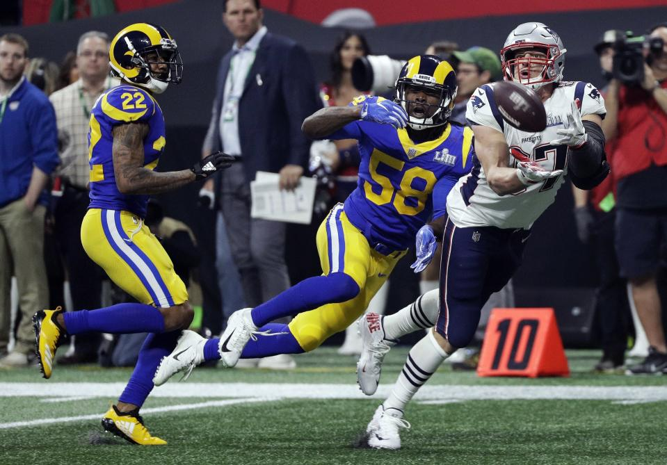 The Patriots' Rob Gronkowski (87) catches a pass in front of the Rams' Marcus Peters (22) and Cory Littleton (58) during the second half. (AP)