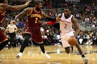 John Wall of the Washington Wizards drives past Kyrie Irving f the Cleveland Cavaliers during the second half at Verizon Center (AFP Photo/Patrick Smith)