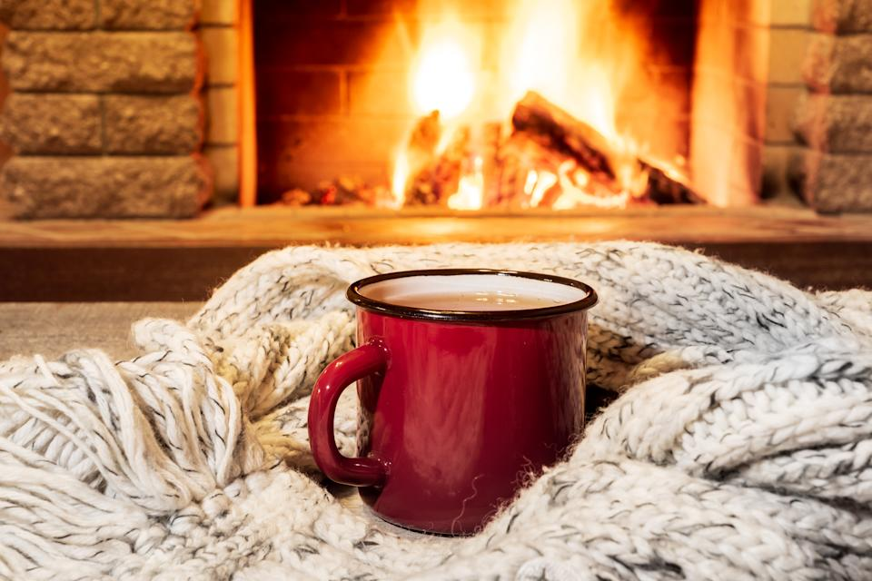 'Tis the season to snuggle up with some hot tea. (Photo: Getty)