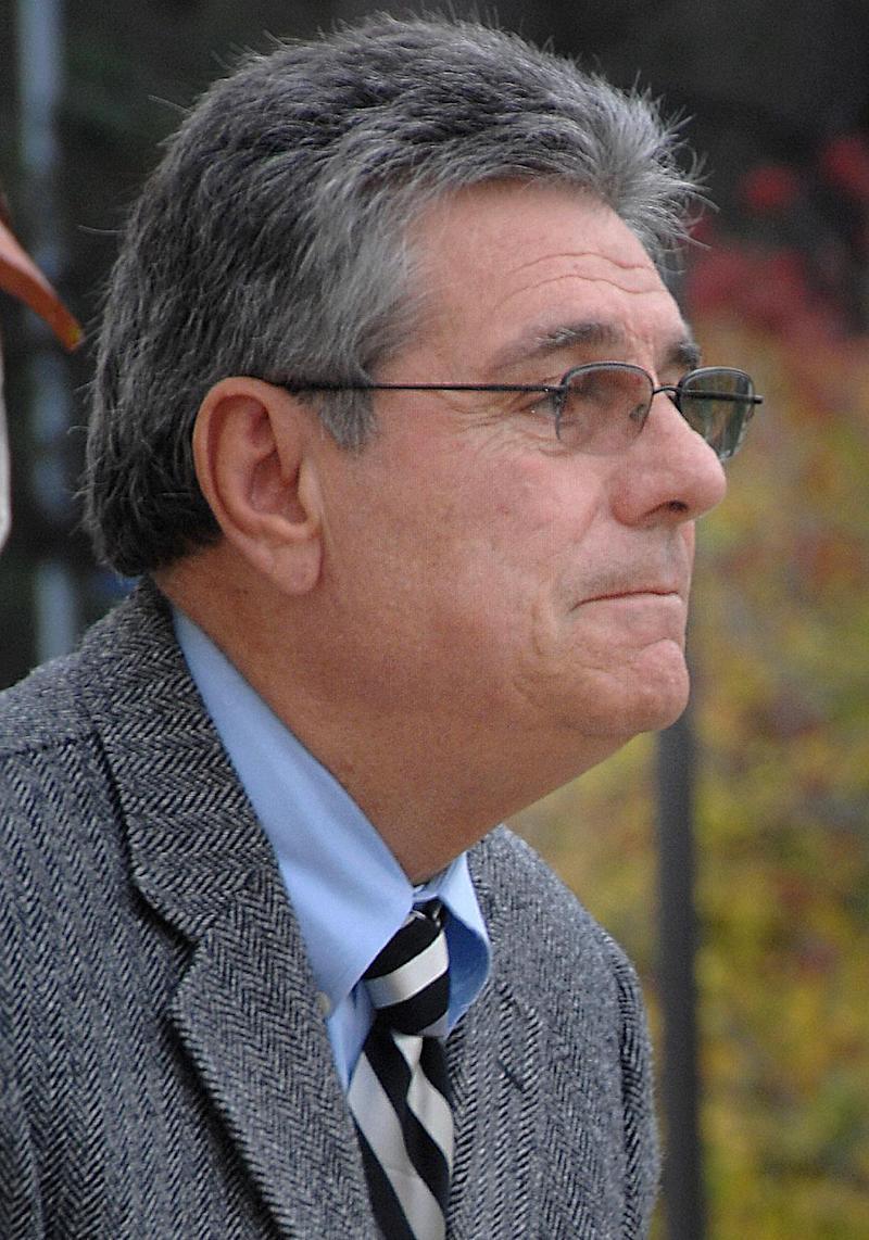 This 2008 photo provided by the U.S. Navy shows Naval Postgraduate School Provost Leonard Ferrari on the university campus outside his office in Herrmann Hall  in Monterey, Calif. Navy Secretary Ray Mabus has fired the top two administrators of the Naval Postgraduate School in Monterey, Calif., for mismanagement and fostering an atmosphere defying Navy regulations, Tuesday, Nov. 27, 2012. (AP Photo/US Navy, Javier Chagoya)