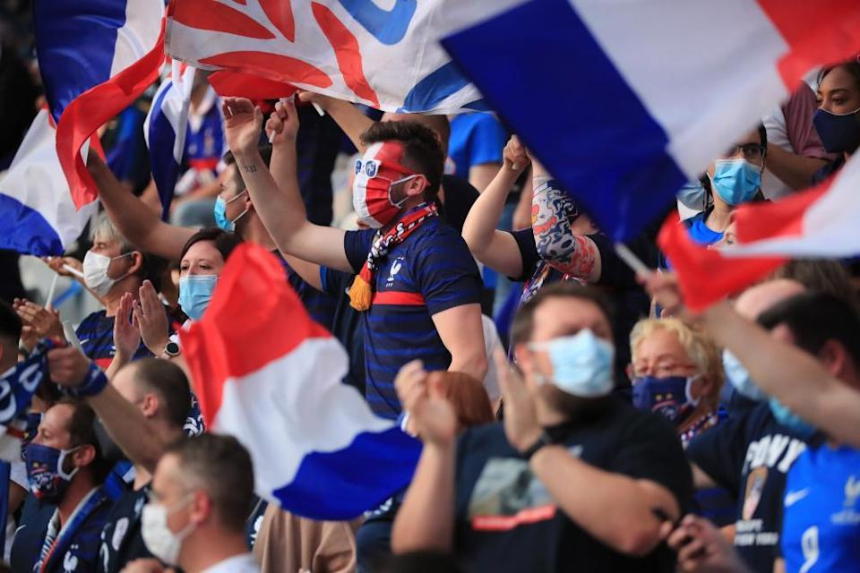 French supporters cheer their team before the friendly at home to Bulgaria in Saint-Denis