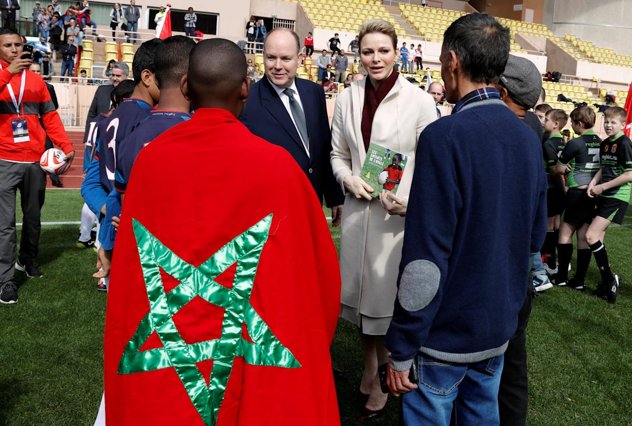 Princess Charlene of Monaco and Prince Albert II greet Tunisia's rugby team before the start of the Sainte Devote rugby tournament in collaboration with Princess Charlene Foundation at Louis II Stadium in Monaco March 18, 2017.               REUTERS/Eric Gaillard