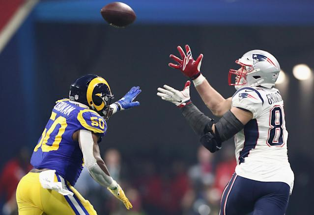 <p>Rob Gronkowski #87 of the New England Patriots tries to make a catch against Samson Ebukam #50 of the Los Angeles Rams in the second half during Super Bowl LIII at Mercedes-Benz Stadium on February 3, 2019 in Atlanta, Georgia. (Photo by Jamie Squire/Getty Images) </p>