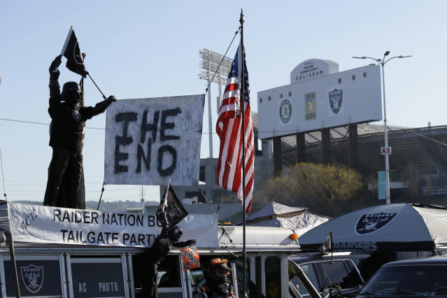 "A sign reads ""The End"" on top of the Raider Nation Bus before the start of an NFL football between the Oakland Raiders and the Jacksonville Jaguars game in Oakland, Calif., Sunday, Dec. 15, 2019. The game is the final scheduled Raiders game in Oakland. (AP Photo/Eric Risberg)"