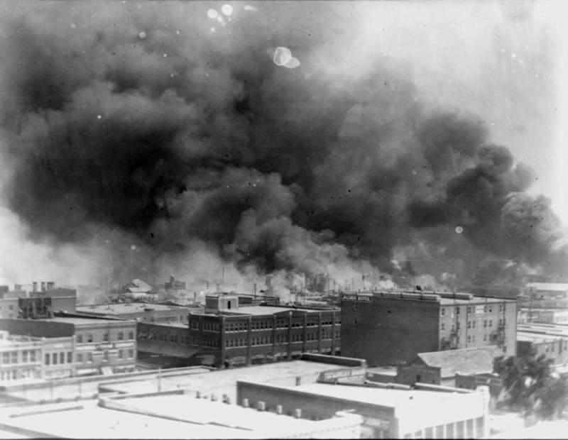 Smoke rises from buildings during the 1921 race riot in Tulsa, Oklahoma.