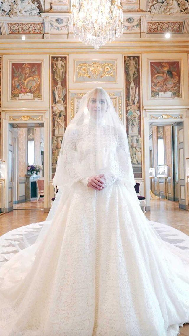 """<p>Dolce & Gabbana revealed they were the masterminds behind Lady Kitty Spencer's wedding dress(es) in a beautiful short film on Instagram. The post gives a glimpse of the five Alta Moda creations the 30 year-old wore to wed 62-year-old Michael Lewis in Italy, including a shot of her white wedding gown that gives us major flashbacks to <a href=""""https://www.elle.com/uk/life-and-culture/a30101259/the-crown-season-4/"""" rel=""""nofollow noopener"""" target=""""_blank"""" data-ylk=""""slk:The Crown"""" class=""""link rapid-noclick-resp"""">The Crown</a>'s depiction of Spencer's late aunt, <a href=""""https://www.elle.com/uk/fashion/celebrity-style/g36273302/royal-wedding-dresses/"""" rel=""""nofollow noopener"""" target=""""_blank"""" data-ylk=""""slk:Princess Diana's, own famous wedding dress"""" class=""""link rapid-noclick-resp"""">Princess Diana's, own famous wedding dress</a>.</p><p><a href=""""https://www.instagram.com/p/CRwDqpeKjX-/"""" rel=""""nofollow noopener"""" target=""""_blank"""" data-ylk=""""slk:See the original post on Instagram"""" class=""""link rapid-noclick-resp"""">See the original post on Instagram</a></p>"""