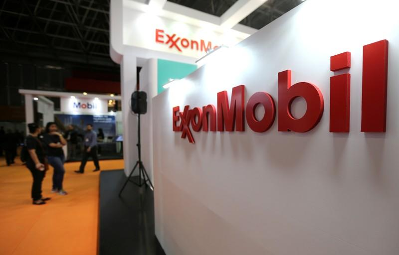 FILE PHOTO: Logo of the Exxon Mobil Corp is seen at the Rio Oil and Gas Expo and Conference in Rio de Janeiro