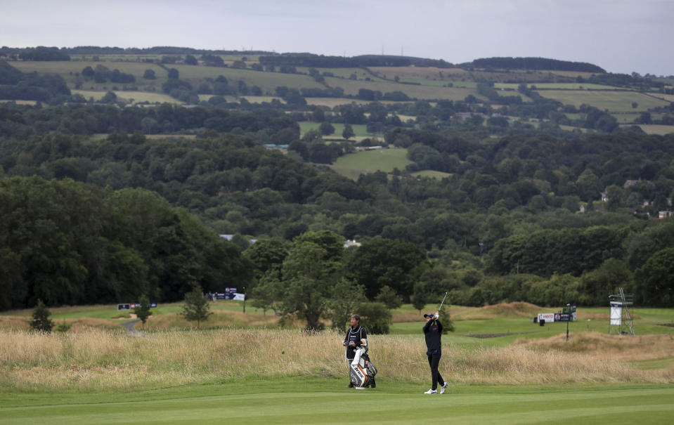Spain's Carlos Pigem plays from the fairway during day one of the British Masters at Close House Golf Club, near Newcastle, England, Wednesday July 22, 2020. The European Tour resumes in earnest after its pandemic-induced shutdown with the British Masters starting Wednesday with plans for players and caddies to be virus tested regularly during the week. (Mike Egerton/PA via AP)