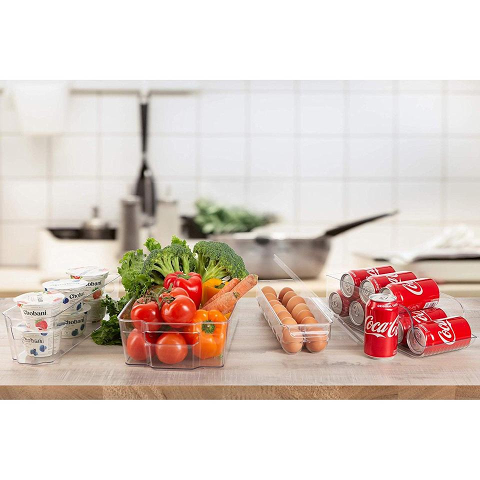 <p>The stackable <span>Refrigerator Organizer Bins</span> ($31) can be used where ever you need storage, not just your refrigerator. It comes with two wide containers, two narrow containers, an egg container, a can organizer, and even a magnetic white board with a marker.</p>