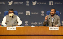 India's Information Technology Minister Ravi Shankar Prasad, left and Information and Broadcasting Minister Prakash Javadekar address a press conference in New Delhi, India, Thursday, Feb. 25, 2021. India on Thursday rolled out new regulations for social media companies and digital streaming websites to make them more accountable for the online content shared on their platforms, giving the government more power to police it. (AP Photo/Manish Swarup)
