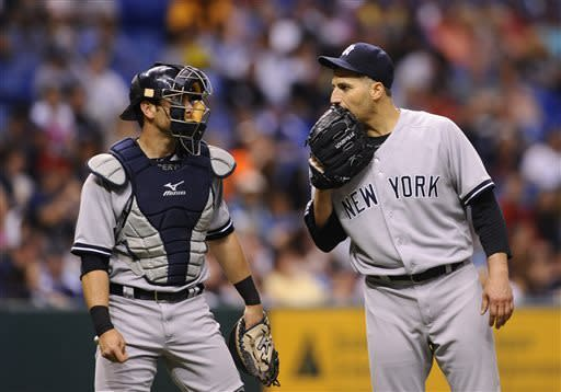 New York Yankees catcher Francisco Cervelli, left, and starting pitcher Andy Pettitte have a discussion on the mound during the sixth inning of a baseball game against the Tampa Bay Rays, Wednesday, April 24, 2013, in St. Petersburg, Fla. (AP Photo/Brian Blanco)