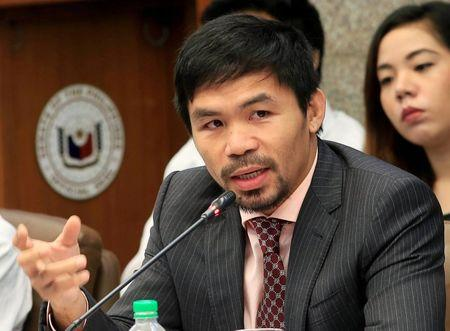 "Philippine Senator and professional boxer Manny ""Pacman"" Pacquiao gestures during the start of a hearing investigating drug-related killings at the Senate headquarters in Pasay city, metro Manila, Philippines August 22, 2016. REUTERS/Romeo Ranoco"