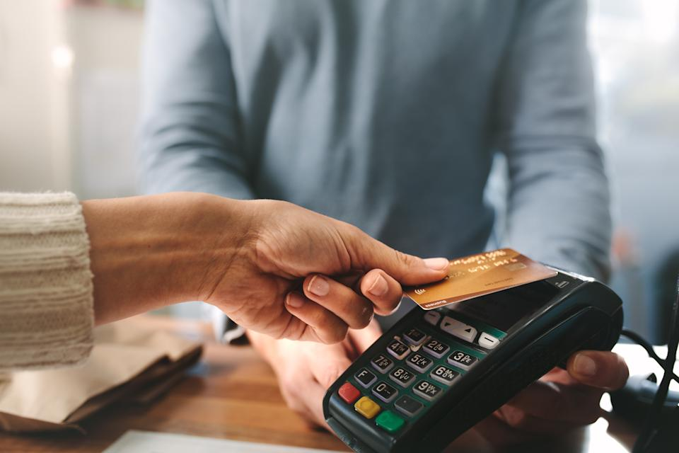 Hands charging with credit card reader. Source: Getty Images