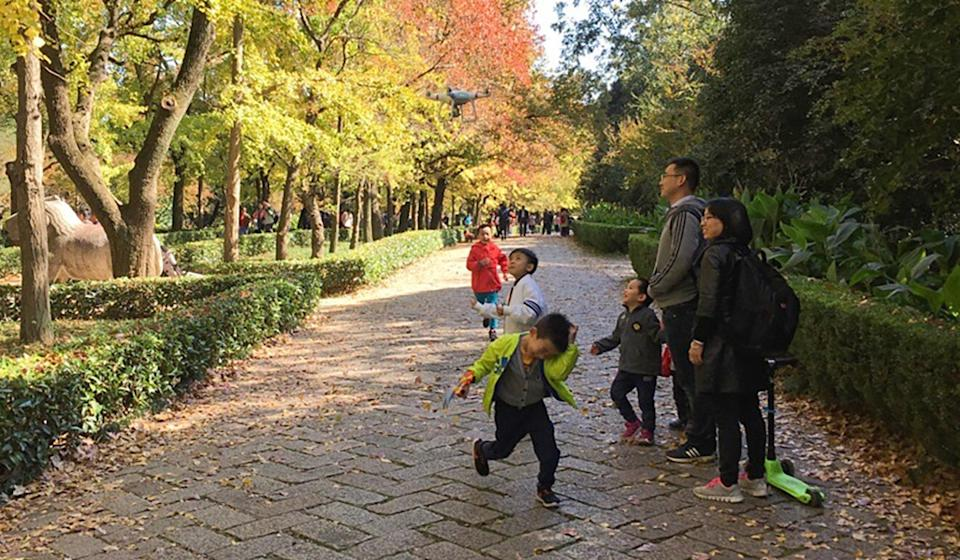 Cai Ning enjoys a day in the park with her family. Photo: Handout