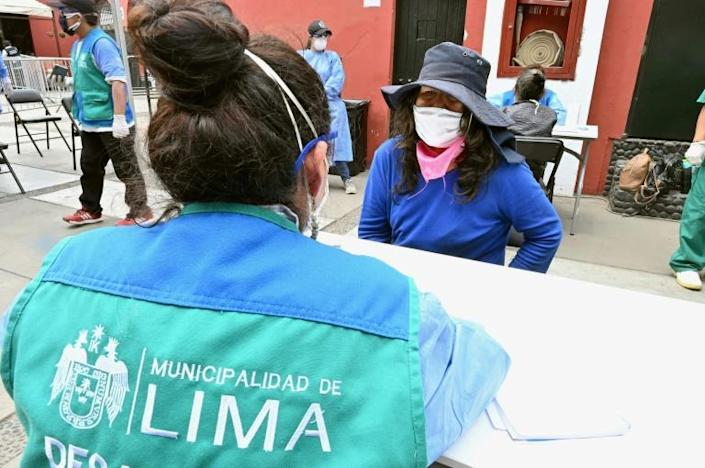 City of Lima employees prepared the historic bullring for its new tenants by fumigating, laying a protective flooring, setting up a giant tent and bringing in beds (AFP Photo/Cris BOURONCLE)