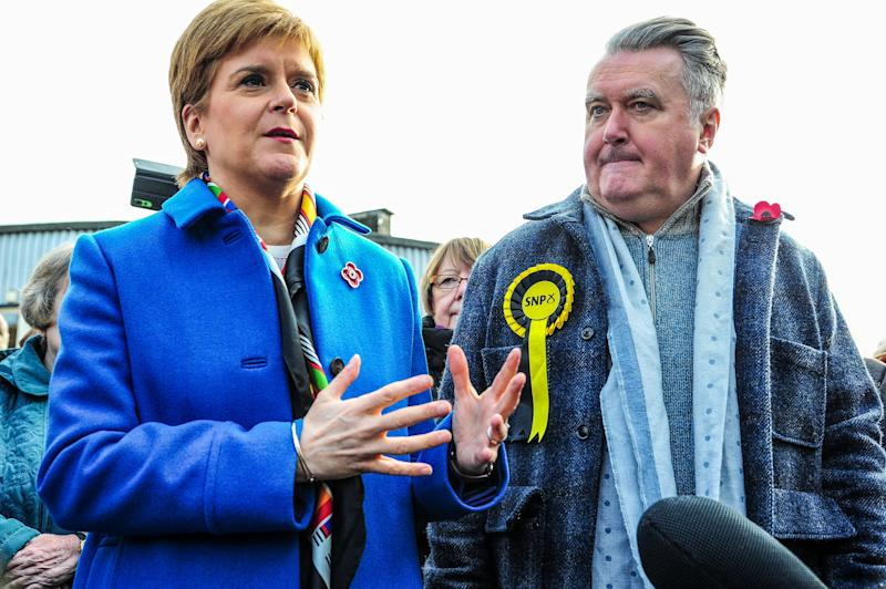 ALLOA, UNITED KINGDOM - 2019/11/06: SNP John Nicolson and Nicola Sturgeon are seen at a press conference during his election campaign ahead of the 2019 General Election. (Photo by Stewart Kirby/SOPA Images/LightRocket via Getty Images)
