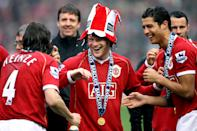 Manchester United's Gabriel Heinze (l), Wayne Rooney (c) and Cristiano Ronaldo celebrate winning the English Premierleague (Photo by Mike Egerton - PA Images via Getty Images)
