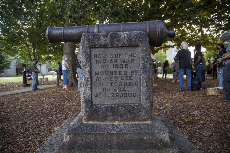 """A cannon monument, installed by the United Daughters of the Confederacy in 1906, is displayed near the Old DeKalb County courthouse in downtown Decatur, Ga., Monday, Oct. 11, 2021. A Georgia county unanimously voted Tuesday to remove the """"genocide cannon"""" from the city square where it resided for more than a century. The cannon in Decatur has ties to the Indian War of 1836 and has become increasingly controversial, drawing criticism from local activists who say it represents the brutal suffering of thousands of Muscogee people who were removed from their native lands. (Alyssa Pointer/Atlanta Journal-Constitution via AP)"""