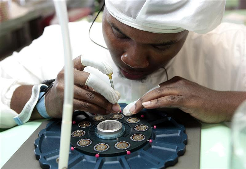 Technician Holley reworks the caliber movements of Shinola watches being assembled at its manufacturing location in Detroit