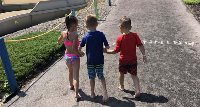 Walking with his friend at the water park