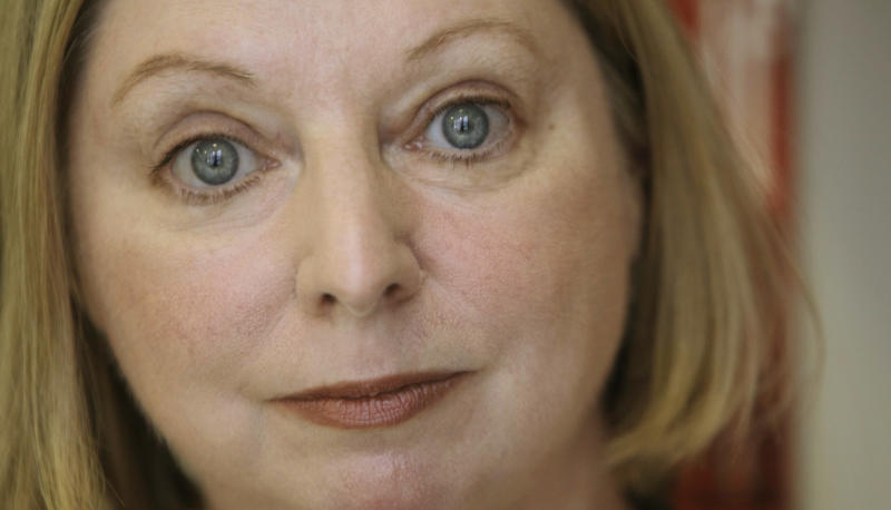 """FILE - The Booker Prize winning author Hilary Mantel poses for a photograph in London in this file photo dated Thursday, Oct. 8, 2009. Mantel is widely criticized in the media Tuesday Feb. 19, 2013, for her """"venomous attack"""" on the former Kate Middleton, the wife of Prince William, for published comments about the British public's complex relationship with royalty quoting Mantel saying the princess is """"a jointed doll on which certain rags were hung"""", and said she appeared to be designed by committee with a perfect plastic smile. (AP Photo/Alastair Grant, File)"""