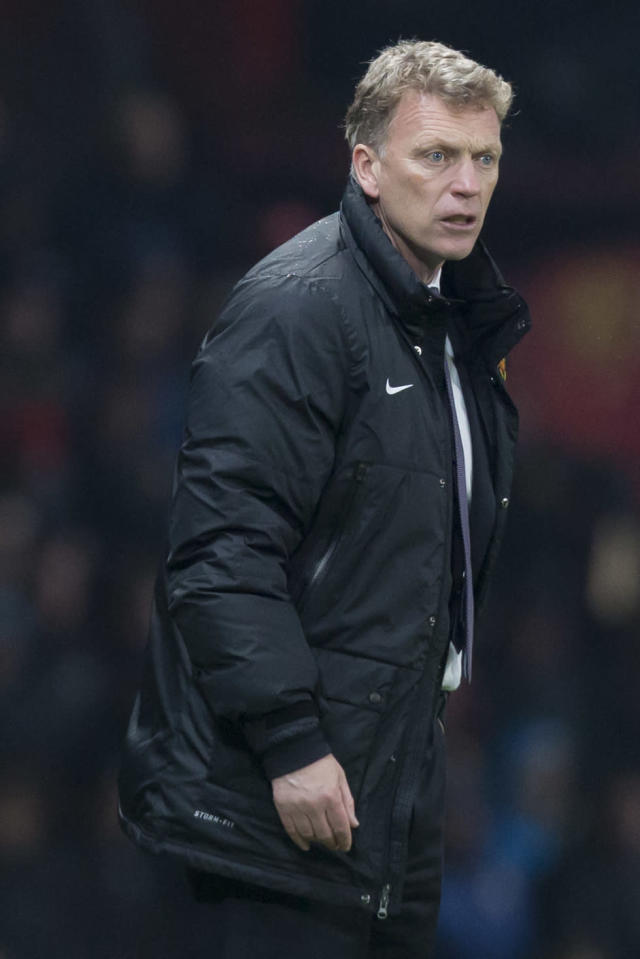 Manchester United's manager David Moyes stands on the touchline during his team's English Premier League soccer match against Manchester City at Old Trafford Stadium, Manchester, England, Tuesday March 25, 2014. (AP Photo/Jon Super)