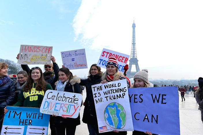 <p>Protestors hold up anti Trump signs as over 2000 people protest during the Women's march on the Trocadero in front of the Eiffel Tower march on January 21, 2017 in Paris, France. (Photo by Aurelien Meunier/Getty Images) </p>