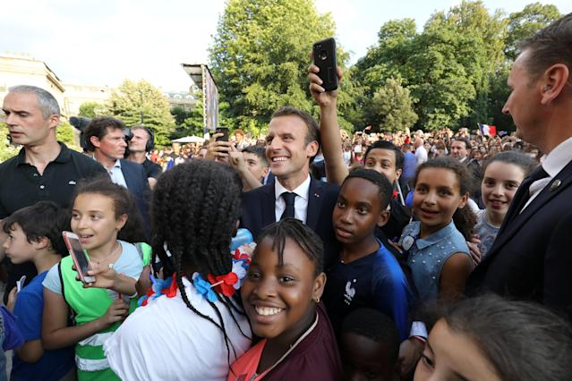 French President Emmanuel Macron poses with supporters during a reception at the Elysee Presidential Palace after they won the Russia 2018 World Cup final football match, in Paris, France July 16, 2018. Ludovic Marin/Pool via Reuters