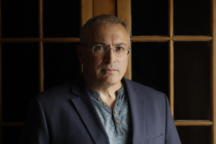 FILE - In this Tuesday, July 24, 2018 file photo, Russian opposition figure Mikhail Khodorkovsky, the former owner of the Yukos Oil Company, poses for a photograph after being interviewed by The Associated Press in London. Russian authorities are ramping up their pressure on dissent ahead of the country's parliamentary election, arresting opposition Andrei Pivovarov, the head of the Open Russia movement that dissolved itself last week and raiding several others' homes. Open Russia was financed by tycoon Mikhail Khodorkovsky, who moved to London after spending 10 years in prison in Russia on charges widely seen as political revenge for challenging President Vladimir Putin's rule. (AP Photo/Matt Dunham, File)
