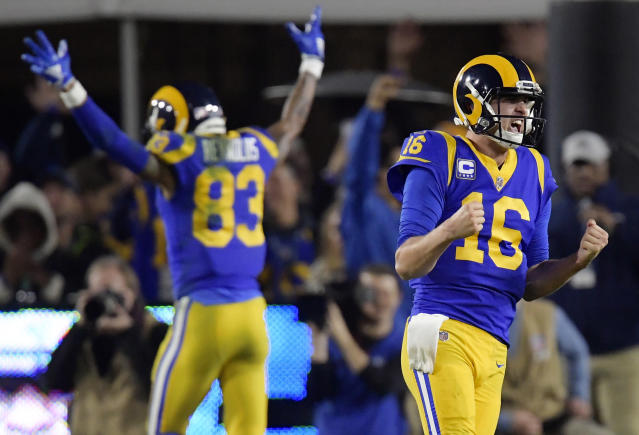 FILE - In this Jan. 12, 2019, file photo, Los Angeles Rams quarterback Jared Goff celebrates after a touchdown by running back C.J. Anderson during the second half in an NFL divisional football playoff game against the Dallas Cowboys in Los Angeles. A year ago at this time, the Los Angeles Rams were fresh off a Super Bowl trip and back-to-back NFC West titles. Now they seem to be looking up at the competition in the NFL's toughest division. (AP Photo/Mark J. Terrill, File)