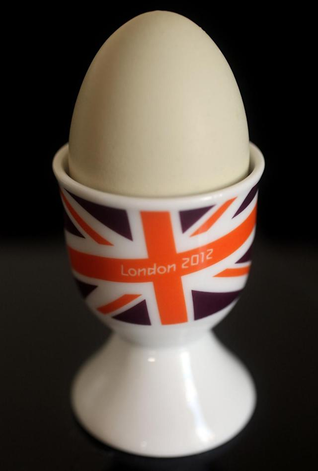 A London 2012 branded egg cup goes on display at the launch of the London Olympic Games official merchandise on July 30, 2010 in London, England. The merchandise is being launched with two years to go before the Games begin and features a range of goods including: clothing, towels, bedding, ceramics, stamps, coins, badges, mascot toys and soft furnishings. (Photo by Oli Scarff/Getty Images)