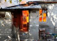 A house is seen set on fire by departing Ethnic Armenians in the village of Cherektar, in the region of Nagorno-Karabakh