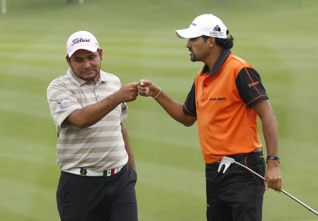 Oscar Serna of Mexico, right, celebrates with his teammate Jose De Jesus Rodriguez at the 6th hole during the third day of the Mission Hills World Cup golf tournament in Haikou, Hainan province, Southern China, Saturday Nov. 26, 2011. (AP Photo/Kin Cheung)