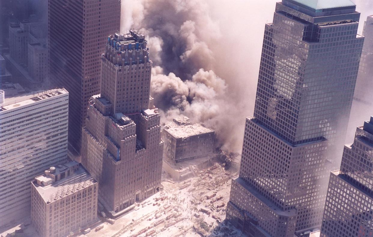 The World Trade Center during the September 11 terrorist attacks. (Photo Credit: NIST)