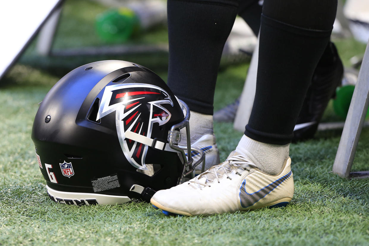 ATLANTA, GA - AUGUST 13: A Falcons helmet on the sidelines during the Friday night preseason NFL game between the Atlanta Falcons and the Tennessee Titans on August 13, 2021 at Mercedes-Benz Stadium in Atlanta, Georgia.  (Photo by David J. Griffin/Icon Sportswire via Getty Images)