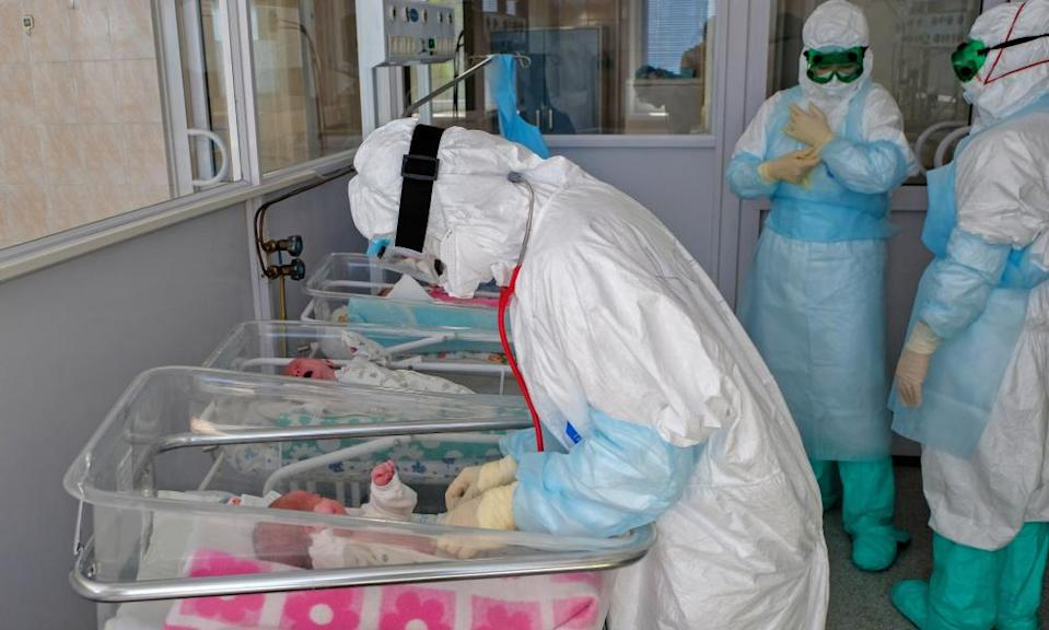 A medical worker examines a newborn baby at a hospital in Khabarovsk.