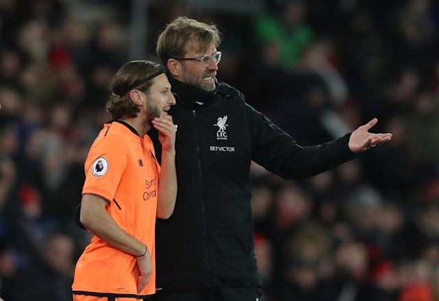 "Soccer Football - Premier League - Southampton vs Liverpool - St Mary's Stadium, Southampton, Britain - February 11, 2018 Liverpool's Adam Lallana talks to manager Juergen Klopp as he waits to be substituted on Action Images via Reuters/Peter Cziborra EDITORIAL USE ONLY. No use with unauthorized audio, video, data, fixture lists, club/league logos or ""live"" services. Online in-match use limited to 75 images, no video emulation. No use in betting, games or single club/league/player publications. Please contact your account representative for further details."