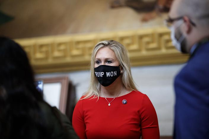 """Representative-elect Marjorie Taylor Greene, a Republican from Georgia, wears a """"Trump Won"""" protective mask at the U.S. Capitol. (Photographer: Ting Shen/Bloomberg via Getty Images)"""